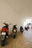Motorbike line-up. A line-up of motorcycles along a tunneled Portuguese street Stock Images
