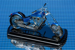 Motorbike model. On blue mirror background Royalty Free Stock Photos