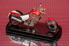Motorbike model. On red mirror background Royalty Free Stock Photos