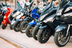 Motorbike, motorcycle scooters parked in row in Stock Photo