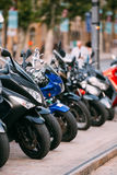 Motorbike, Motorcycle Scooters Parked In Row In City Street. Royalty Free Stock Images