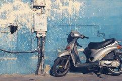 Motorbike near dirty wall Stock Photo
