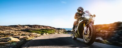 Free Motorbike On The Coastal Road Riding. Having Fun Driving The Empty Highway On A Motorcycle Tour Journey Stock Photography - 169539332