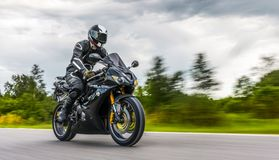 Free Motorbike On The Road Riding. Having Fun Riding The Empty Road O Royalty Free Stock Photo - 128368445