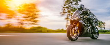 Free Motorbike On The Road Riding. Having Fun Riding The Empty Road O Royalty Free Stock Images - 128368469
