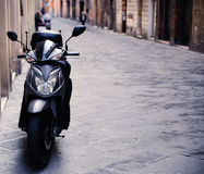 Motorbike parked on the street Stock Photography