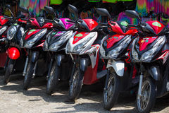 Motorbike parked on the street for rent to tourists. Island Koh Phangan, Thailand Royalty Free Stock Images