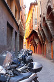 Motorbike parking on Bologna old narrow street Stock Images