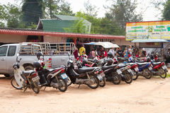 Motorbike parking on the market in Khao Lak Stock Images