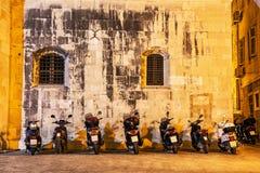 Motorbike parking near the wall of Trogir cathedral, Croatia, ni. Motorbike parking near the wall of Trogir cathedral, Croatia, Unesco. Night scene. Travel Royalty Free Stock Photos
