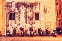 Motorbike parking near the wall of Trogir cathedral, Croatia, re. Motorbike parking near the wall of Trogir cathedral, Croatia, Unesco. Night scene. Travel Stock Photography