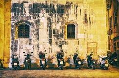 Motorbike parking near the wall of Trogir cathedral, Croatia, ye. Motorbike parking near the wall of Trogir cathedral, Croatia, Unesco. Night scene. Travel Stock Photo