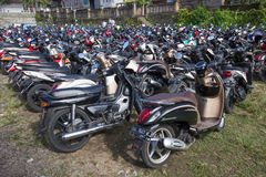 Motorbike parking on the street. Ubud, Indonesia Stock Photos