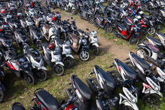 Motorbike parking on the street. Ubud, island Bali, Indonesia Royalty Free Stock Photo