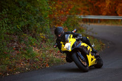Motorbike pilot coming out from curve Royalty Free Stock Photography