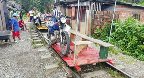 Motorbike powered trolleys. The local method of transportation in and out of the san cipriano jungle Stock Image