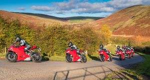 Red Motorbike Progression. Motorbike progression in an action sequence on a country road in Upper Coquetdale, Northumberland Royalty Free Stock Photos