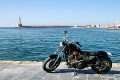Motorbike on quay. Seascape with motorbike into the foreground Stock Photos