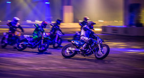 Motorbike Race, Autosport International 2016. Motorbike riders in a race during the performance car show at Autosport International 2016 Stock Photography