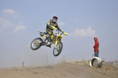 Motorbike racer performs a jump efficient Stock Image