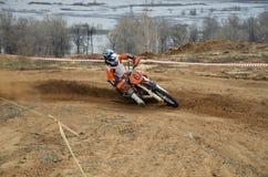 Motorbike racer turns sharply Stock Photography
