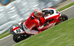Motorbike Racing. A motorbike racing in circuit, visible panning Royalty Free Stock Photos
