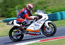 Motorbike racing. BUDAPEST, HUNGARY - APR 25- Alpe-Adria Championship: Motovia Motoclub team rider :RAUCH Peter of SK speeds up after the bend it the 2009 pre Royalty Free Stock Images