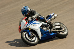 Motorbike racing. Rider racing his motorbike on the track stock photos