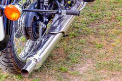 Motorbike rear tire with silencer stock photo