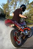 Motorbike Rider Doing Stunt Royalty Free Stock Photos