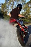 Motorbike Rider Doing Stunt Stock Photography