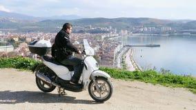 Motorbike rider at Gemlik, Bursa, Turkey, High angle stock footage