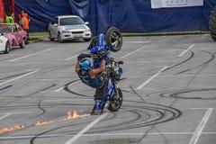 Motorbike riding on one wheel Royalty Free Stock Photo