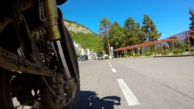Motorbike riding round the town stock footage