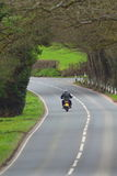 Motorbike on the road. In Devon, England Royalty Free Stock Image