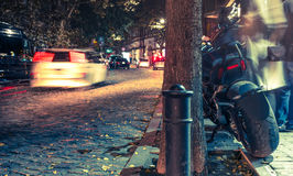 Motorbike on a road at night. On illuminated street Royalty Free Stock Images