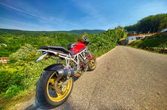 Motorbike on Road. Red motorbike on country road landscape Stock Photography
