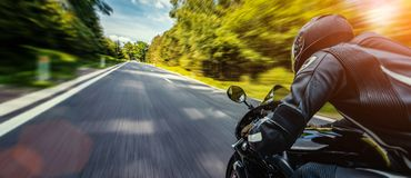 Motorbike on the road riding. having fun riding the empty road on a motorcycle tour / journey royalty free stock photos
