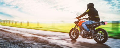 Motorbike on the road riding. having fun riding the empty road Royalty Free Stock Images