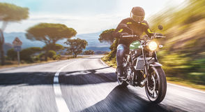 Motorbike on the road riding. having fun riding the empty road o Royalty Free Stock Photography