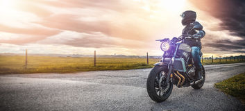 Motorbike on the road riding. having fun riding the empty road o Stock Image