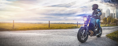 Motorbike on the road riding. having fun riding the empty road o Stock Images
