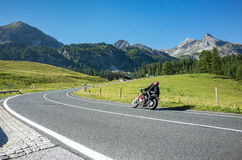 Motorbike on the route. Close view on the motorbike on the route in the mountains Royalty Free Stock Photos