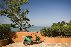 Motorbike by sea. Motorcycle by caribbean sea sosua bay dominican republic with condominium construction Royalty Free Stock Photo