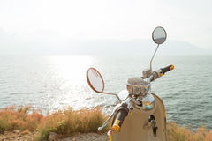 Motorbike beside the sea Stock Images