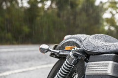 Motorbike seat in rain Stock Photography