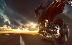 Motorbike. On a seemingly endless road stock photo