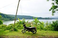 Motorbike side Sea lake. Gia Lai, Viet Nam Royalty Free Stock Image