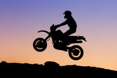 Motorbike silhouette. Silhouette of biker jumping through the air Royalty Free Stock Photography