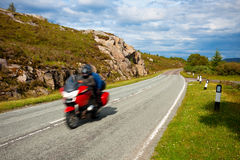 Motorbike Speeding on Country Road Stock Photo